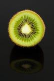 Half of Kiwi Fruit with Reflection on Black Background Stock Image