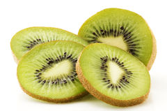 Half kiwi with some slices. One kiwifruit and some slices isolated on white background royalty free stock photo