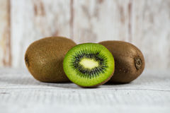 Half kiwi and two kiwi Stock Photography