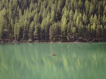 Half lake, half forest, and one small boat. Detail. Half lake, half forest, and one small boat. In Italy royalty free stock photos