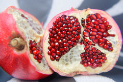 Half a large red pomegranate. On linen the tablecloth stock photo