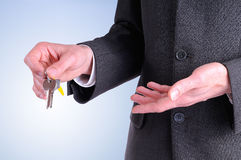 Half lateral body commercial agent with keys in hand isolated Royalty Free Stock Image