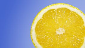 Half lemon against blue background