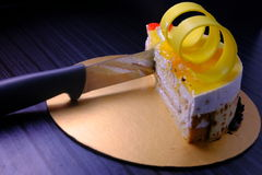 Half Lemon cake with knif  with on black background Royalty Free Stock Photo