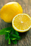 Half lemon and fresh mint Royalty Free Stock Photography