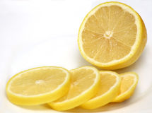 Half of lemon and lemon slices Royalty Free Stock Photo