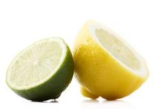 Half lemon and lime. One half lemon and half lime on white background royalty free stock image