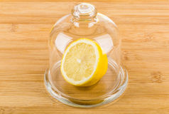 Half lemon in transparent saucer with lid Royalty Free Stock Images