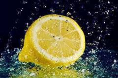 Half of lemon with water drops Stock Image