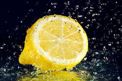 Half of lemon with water drops Stock Photo