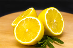 Half of lemon on a wooden board. Lemons  on a wooden background. Stock Images