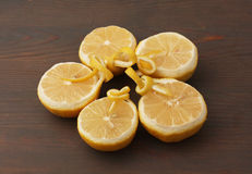 Half lemons on wood Royalty Free Stock Images