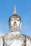 Half-length of large Buddha image and blue sky Royalty Free Stock Image