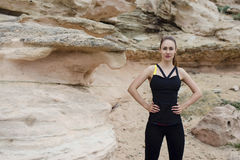 Half length portrait of a beautiful female jogger posing while taking break between intense exercising outdoors Stock Image
