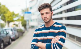 Half length portrait of a beautiful young man in the city royalty free stock photography