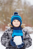 Half-length portrait of boy who stands in winter park Stock Photo