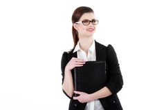 Half-length portrait of business lady with folder wearing black. Frame glasses, isolated on white Royalty Free Stock Photography