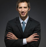 Half-length portrait of business man with arms crossed. Half-length portrait of business man with his arms crossed. Concept of professionalism and business Stock Image