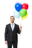 Half-length portrait of business man with balloons. Isolated on white Royalty Free Stock Photography
