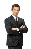Half-length portrait of business man with crossed hands. Isolated on white. Concept of leadership and success Stock Image