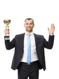 Half-length portrait of business man with golden cup Stock Images
