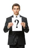 Half-length portrait of business man with question mark Stock Photo