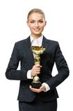 Half-length portrait of business woman keeping gold cup Royalty Free Stock Photography