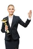 Half-length portrait of business woman keeping golden cup Royalty Free Stock Photography