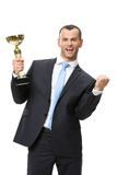 Half-length portrait of businessman with golden cup Royalty Free Stock Images