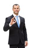 Half-length portrait of businessman ok gesturing Royalty Free Stock Images