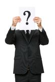 Half-length portrait of businessman with question mark in front of face Royalty Free Stock Image