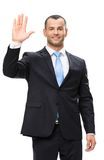 Half-length portrait of businessman waving hand royalty free stock photography