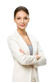 Half-length portrait of businesswoman with arms crossed Stock Photo