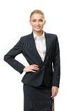 Half-length portrait of businesswoman with hand on hip. Half-length portrait of businesswoman with her hand on hip, isolated on white. Concept of leadership and stock images