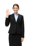 Half-length portrait of businesswoman waving hand Royalty Free Stock Image