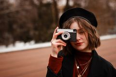 Half length portrait of curly girl photografer taking picture royalty free stock photos