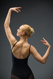 Half-length portrait of dancing female ballet dancer with hands up royalty free stock photo