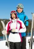 Half-length portrait of embracing alps skiers Stockfotografie