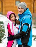 Half-length portrait of embracing couple outdoors Stock Images