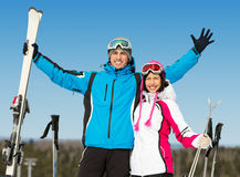 Half-length portrait of embracing downhill skiers Stock Photo