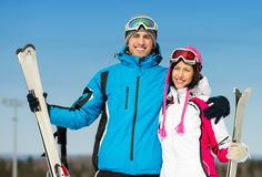 Half-length portrait of embracing skiers Stock Image