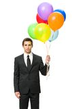 Half-length portrait of executive with balloons. Half-length portrait of business man handing colorful balloons, isolated on white. Concept of holiday and Stock Photo