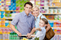 Half-length portrait of family in the shop. Concept of consumerism and family relations Royalty Free Stock Photo