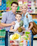 Half-length portrait of family in the store Royalty Free Stock Photos