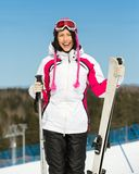 Half-length portrait of female alps skier Stock Photography