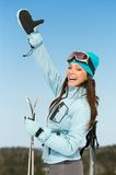 Half-length portrait of female alps skier thumbing up Royalty Free Stock Photos