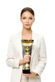 Half-length portrait of female executive with gold cup Royalty Free Stock Photography