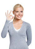 Half-length portrait of female okay gesturing Stock Photography
