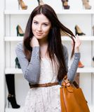 Half-length portrait of female in shopping center Royalty Free Stock Image