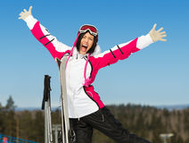 Half-length portrait of female skier with hands up Royalty Free Stock Images